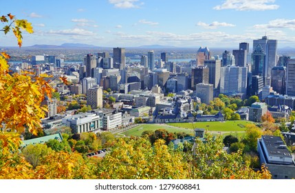 MONTREAL, CANADA -18 OCT 2018- Scenic view of the city of Montreal in Quebec  with colorful autumn foliage from the Chalet du Mont Royal (Mount Royal) Kondiaronk belvedere viewpoint.