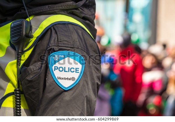 Montreal, Canada - 19 March 2017: Close-up of a police patch with crowd n the background at St. Patrick's Day parade