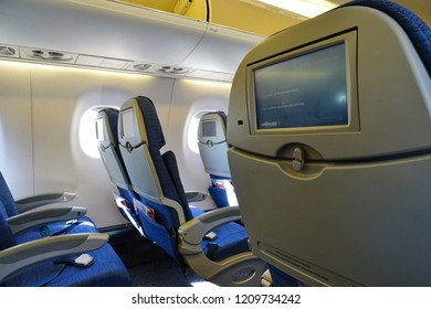 MONTREAL, CANADA -19 OCT 2018- Interior view of economy coach seats inside an Embraer 175 airplane from Air Canada (AC).
