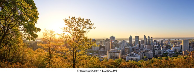 Montreal, Canada, 21 May 2018. Beautiful golden sunrise over the Montreal city. Amazing panorama of Montreal downtown skyline in the morning hours. Golden sun light view from Mont-Royal park.