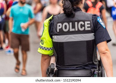 Montreal, Canada - 22 September 2019: Rear view of a policewoman at the Montreal Marathon.