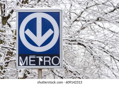 Montreal, Canada - 25 March 2017: Montreal STM Subway blue sign during a snowstorm