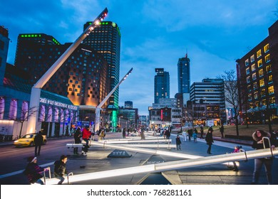 Montreal, Canada _ December 3, 2017. Place Des Arts Square are Night with Kids and Parents having Fun on Seesaws that Change Light Intensity and also Makes Music.