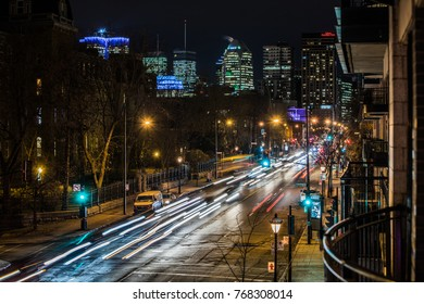 Montreal, Canada _ November 22, 2017. Sherbrooke Traffic Cars Lights during the Evening Rush Hour