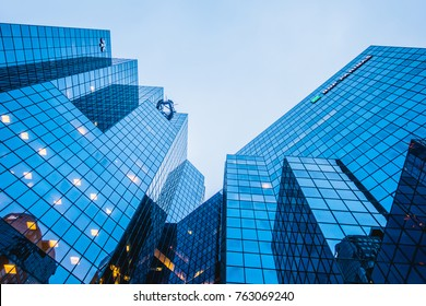 Montreal, Canada _ November 25, 2017. Abstract and Complex Blue Skyscraper Structure Downtown in Montreal with Sky in Background