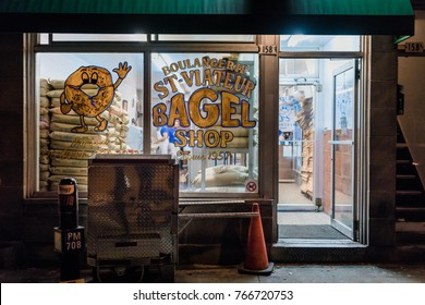 Montreal, Canada _ November 30th, 2017. St-Viateur Bagel Storefront at Night. Well known 24hr Handmade Bagel Company in Montreal