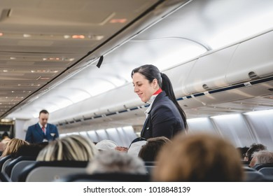 MONTREAL, CANADA _March 16th 2017. Staff Taking Care of Passengers before Takeoff from the Interior of Air Transat Airplane in Direction of San Andres Island.