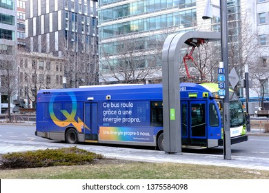 MONTREAL, CANADA - APRIL 13 2019: Electric bus at charging station. STM, the public transportation agency of Montreal, runs three fully electric buses as a trial.