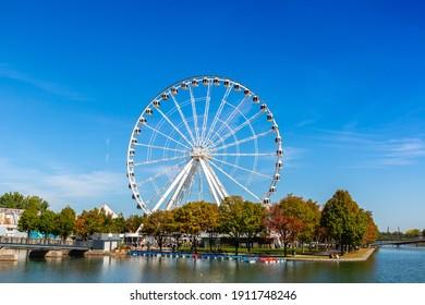 MONTREAL, CANADA - APRIL 2, 2020: Observation Ferris wheel (La Grande Roue de Montreal) in Montreal in a sunny day, Quebec, Canada