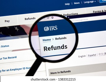 MONTREAL, CANADA - APRIL 24, 2019 : IRS Refunds USA Government home page under magnifying glass. IRS.com is an official web site of Internal Revenue Service