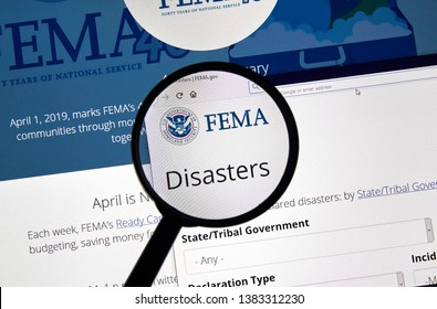 MONTREAL, CANADA - APRIL 24, 2019 : Fema.gov Disasters USA Government home page under magnifying glass. FEMA is The Federal Emergency Management Agency