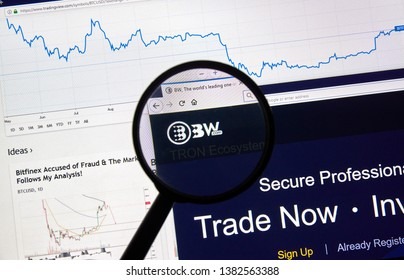 MONTREAL, CANADA - APRIL 26, 2019: BW.com cryptocurrency digital assets exchange logo and home page on a laptop screen under magnifying glass.