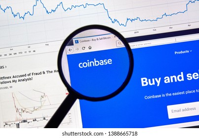 MONTREAL, CANADA - APRIL 26, 2019: Coinbase cryptocurrency digital assets exchange logo and home page on a laptop screen under magnifying glass.