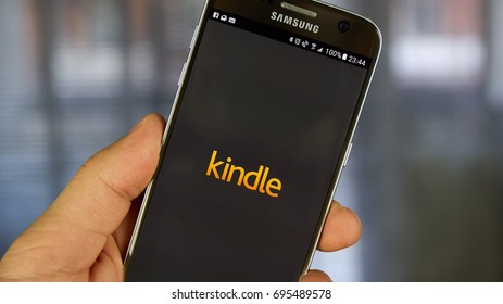 MONTREAL, CANADA - APRIL 30, 2017 : Kindle android application on a cell phone. The Amazon Kindle is a series of e-readers designed and marketed by Amazon.com