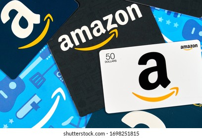 Montreal, Canada - April 6, 2020: Different Amazon gift cards. Amazon is a titan of e-commerce, payments, hardware, data storage, cloud computing, and media. It is founded and run by Jeff Bezos