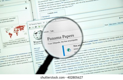 MONTREAL, CANADA - APRIL 7, 2016 : The Panama Papers article on Wikipedia under magnifying glass. The Panama Papers is set of 11.5 million leaked confidential documents.