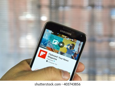 MONTREAL, CANADA - APRIL 7, 2016 : Flipboard application on a cell phone. Flipboard is a social-network aggregation, magazine-format mobile app.