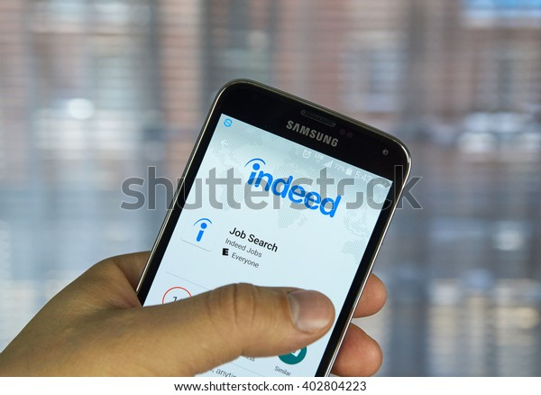 MONTREAL, CANADA - APRIL 7, 2016 : Indeed job search application on a cell phone. Indeed is a global online employment solution for people seeking jobs.