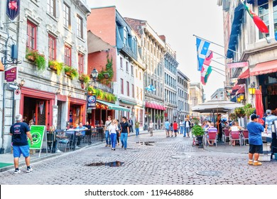 MONTREAL, CANADA - AUG 20, 2012: People meander at the junction of Rue Saint-Paul and Rue Saint-Vincent in the Old Montreal section of Montreal. They are the oldest streets in Montreal.