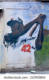 MONTREAL CANADA AUG. 30:Street art Montreal Jackie Robinson on august 30 2014 in Montreal Canada. Montreal. is the perfect place to walk in the back alleys and abandoned areas, looking for street art