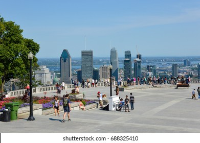 Montreal, Canada - August 01, 2017: Many tourists are standing on Kondiaronk Belvedere to enjoy Montreal skyline. Montreal Skyline in summer, Canada