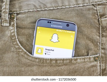 MONTREAL, CANADA - AUGUST 10, 2018: Snapchat app on a cellphone screen in a jeans pocket. Snapchat is a multimedia messaging app used globally, created by Evan Spiegel, Bobby Murphy, and Reggie Brown