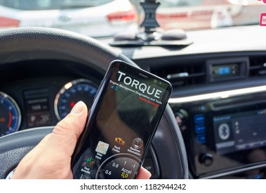 MONTREAL, CANADA - AUGUST 10, 2018: Torque PRO android app in a car. Torque is a car performance, diagnostics tool and scanner that uses an OBD II Bluetooth adapter to connect to management.