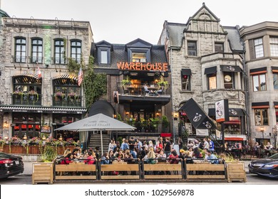 MONTREAL, CANADA - AUGUST 13, 2017: Crescent Street - southbound street located in downtown Montreal. Crescent Street - popular attraction for tourists and locals with nightclubs, bars, restaurants.