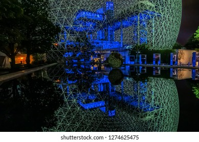 MONTREAL, CANADA - AUGUST 13, 2017: Color lighting of Biosphere (1967) at Parc Jean-Drapeau on Saint Helen's Island at night. Biosphere is a museum in Montreal dedicated to the environment.
