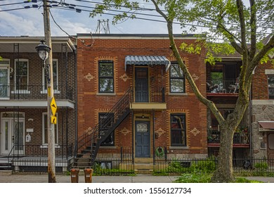 MONTREAL, CANADA - AUGUST 13, 2017: Saint-Denis Street (Rue Saint-Denis) in the Latin quarter of Montreal with many very old Victorian style houses.