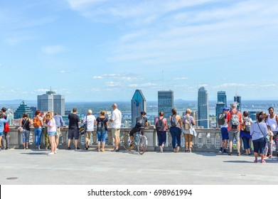 Montreal, Canada - August 16, 2017: Many tourists are standing on Kondiaronk Belvedere to enjoy Montreal skyline. Montreal Skyline in summer, Canada