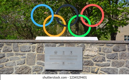 MONTREAL CANADA AUGUST 17 2016: Olympic rings to commemorate the Montreal 1976, Calgary 1988 and Vancouver 2010 olympic games in Canada near the Canada Olympic House