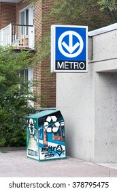 MONTREAL, CANADA - AUGUST, 2015 - Blue sign of Montreal's metro on a building.