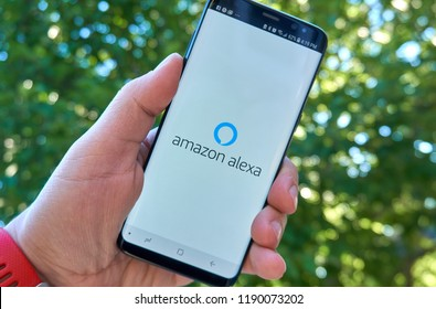 MONTREAL, CANADA - August 28, 2018: Amazon Alexa android app on Samsung s8 screen in a hand. Amazon Alexa is a virtual assistant developed by Amazon,