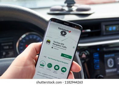 MONTREAL, CANADA - AUGUST 8, 2018: TomTom GPS Navigation Traffic application on a cell phone screen in a car. TomTom is one of the popular gps navigation services.