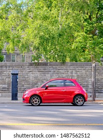 MONTREAL, CANADA - CIRCA AUGUST 2019: Distinct retro style of FIAT 500 is based on 1957 original model that's considered as one of the first purpose-built city cars.