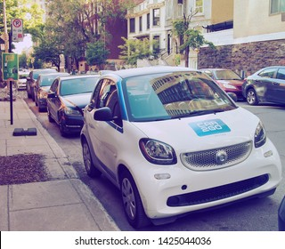 MONTREAL, CANADA - CIRCA JUNE 2019: German car rental company car2go, a subsidiary of Daimler AG, offers Smart and Mercedes-Benz vehicles and features one-way point-to-point rentals.