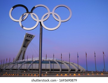 Montreal, Canada - Dec 17 2011: Olympic Stadium and rings for 1976 Games where Nadia Comaneci became the first female to score the perfect 10 during the 1976 Olympic games in Montreal, Canada.