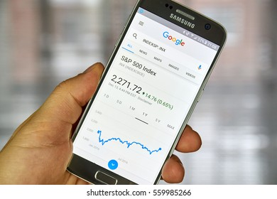 MONTREAL, CANADA - DECEMBER 23, 2016 : Google Finance page with stock chart and s p 500 index on Samsung S7 screen.