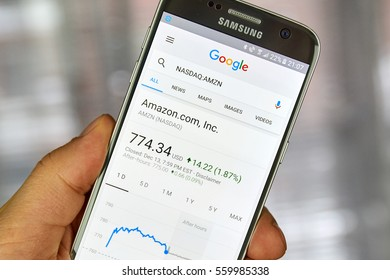 MONTREAL, CANADA - DECEMBER 23, 2016 : Google Finance page with stock chart and Amazon ticker on Samsung S7 screen.