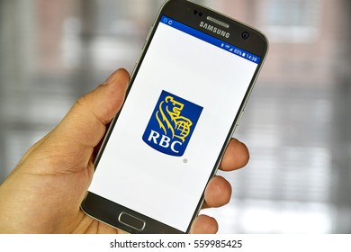 MONTREAL, CANADA - DECEMBER 23, 2016 : RBC logo and mobile app on Samsung S7 screen. The Royal Bank of Canada is a Canadian multinational financial services company and the largest bank in Canada.