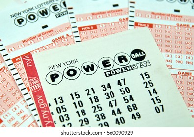 MONTREAL, CANADA - DECEMBER 23, 2016 : Powerball New York lottery tickets. Powerball is an American lottery game offered by 44 states, the District of Columbia, Puerto Rico and the US Virgin Islands.