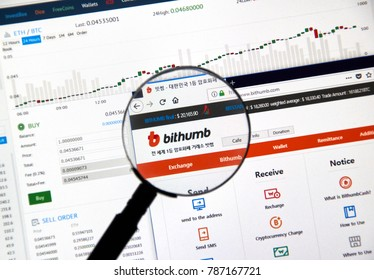 MONTREAL, CANADA - DECEMBER 23, 2017 : Bithumb cryptocurrency exchange website under magnifying glass