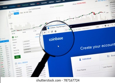 MONTREAL, CANADA - DECEMBER 23, 2017 : Coinbase cryptocurrency exchange website under magnifying glass
