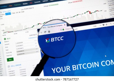 MONTREAL, CANADA - DECEMBER 23, 2017 : BTCC cryptocurrency exchange website under magnifying glass