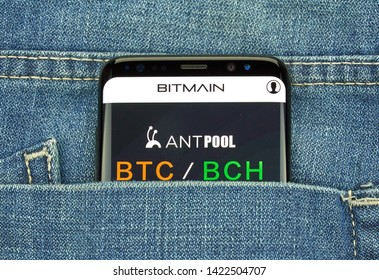 MONTREAL, CANADA - December 23, 2018: Bitmain, Antpool logo and BTC BCH pair on Samsung s8 screen. Bitmain is company that designs ASIC chips for bitcoin mining.