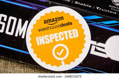 MONTREAL, CANADA - DECEMBER 24, 2018: Amazon Warehouse Inspected logo on an original Amazon Warehouse box. Amazon Warehouse is a business owned by Amazon that sells quality used products.