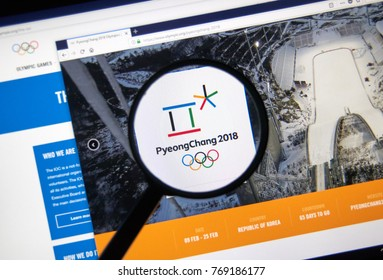 MONTREAL, CANADA - DECEMBER 5, 2017: International Olympic Committee official web page under magnifying glass with logo and information on Winter Olympic games in Pyeongchang in 2018.