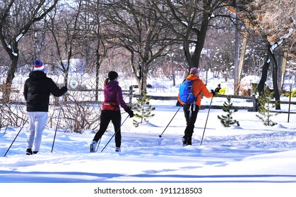 Montreal, Canada - Feb 1, 2021: People doing cross country skiing in the park of Canada