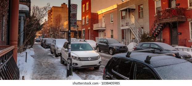 MONTREAL, CANADA - FEBRUARY 18, 2018: Cars parked along narrow streets in the Plateau neighborhood of Montreal.